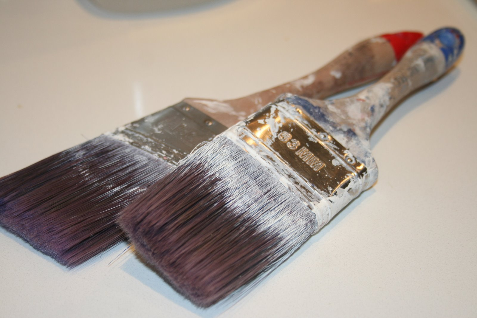 Cleaning Paint Brush And Rollers